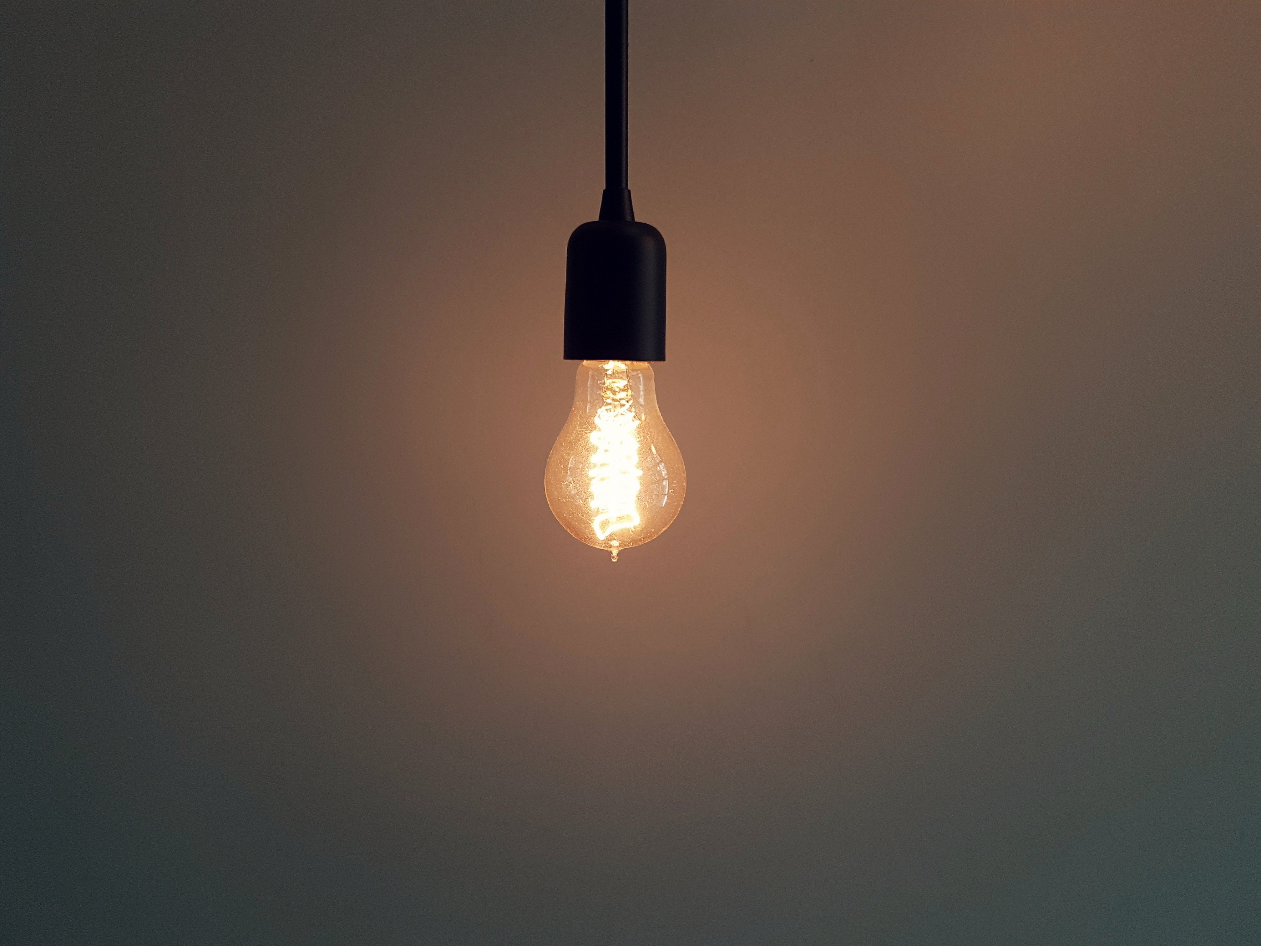 light bulb hanging from cable