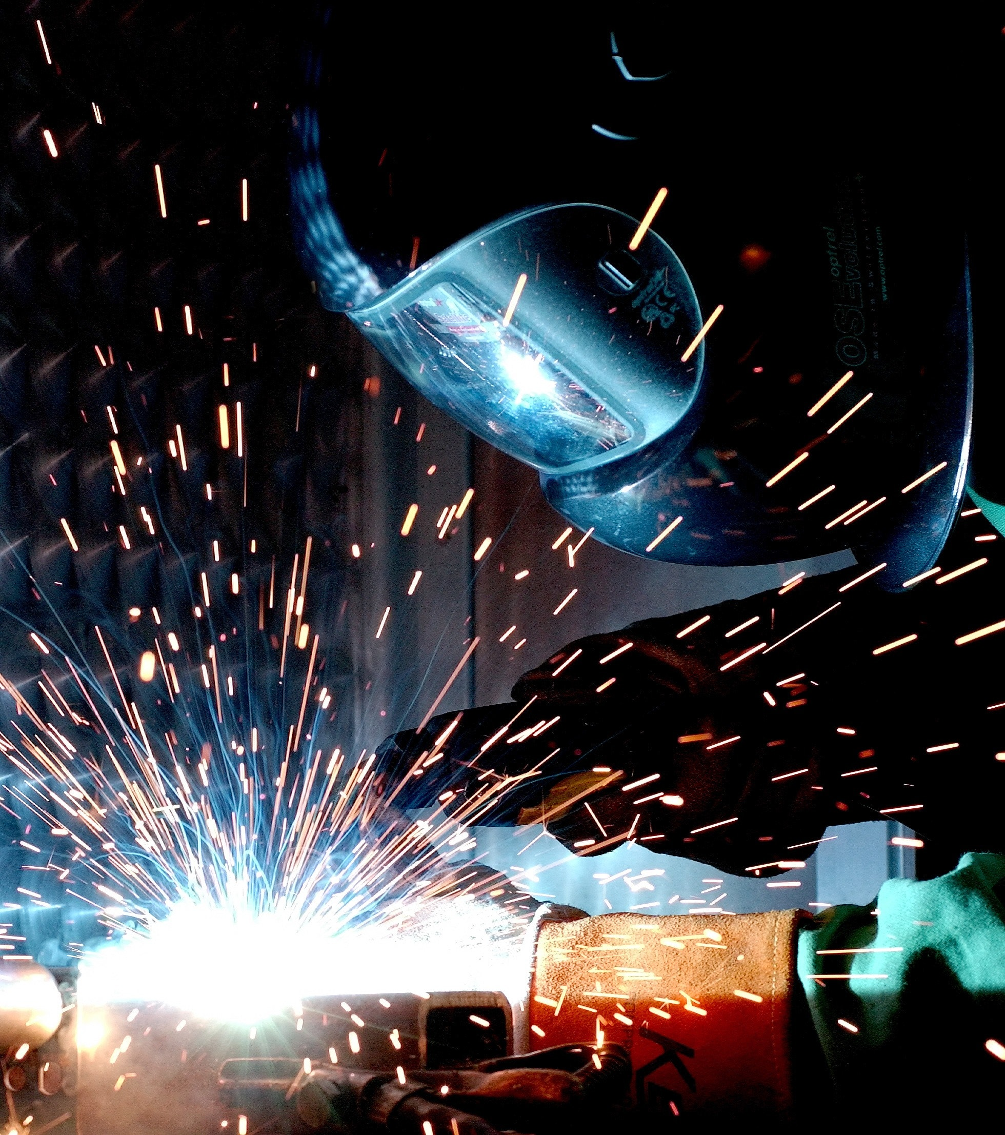person in welding mask welding