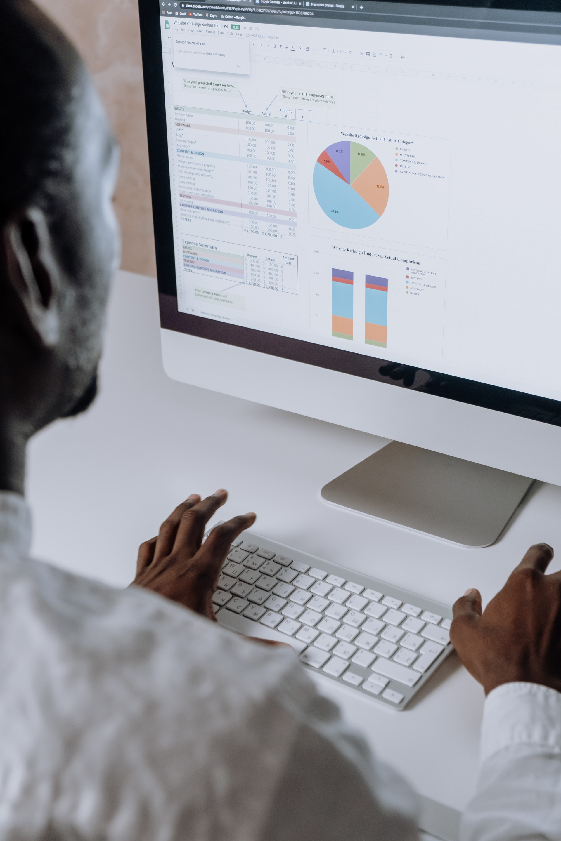 person looking at computer screen with graphs