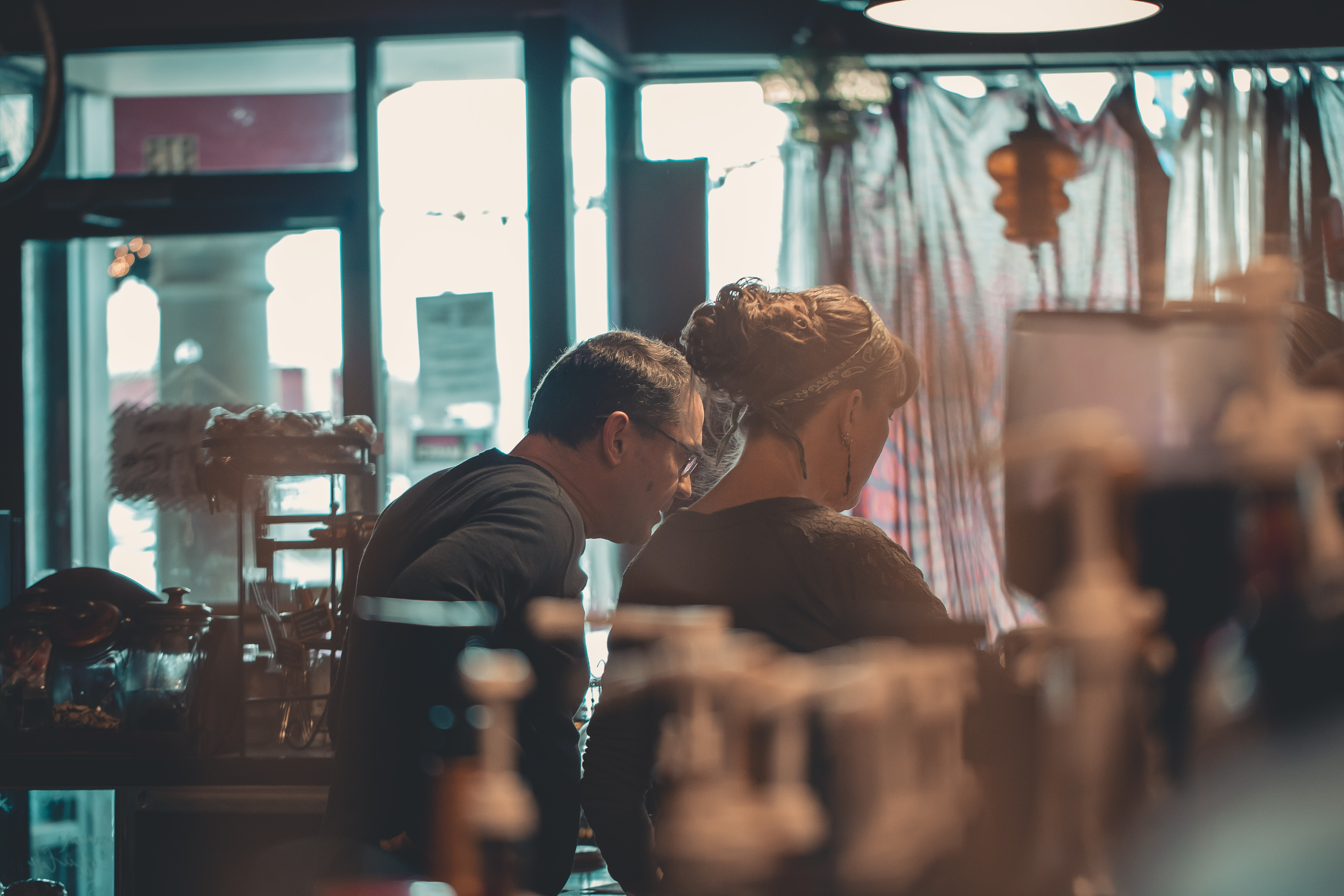 Two people looking through store window