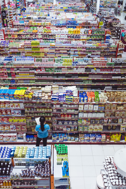 rows of filled shelves at supermarket